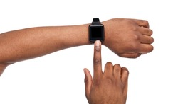 Smart watch at black male hand, white background cutout. Smartwatch - modern digital gadget with empty display, copy space