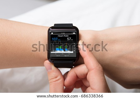 Smart Watch Showing Heartbeat Monitor On Woman's Hand