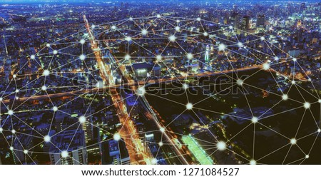 Smart wireless network and Connection technology concept with Osaka city background at night in Japan, panorama view