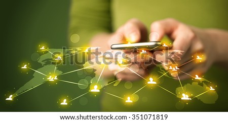 Smart woman holding telephone with world social media network connection