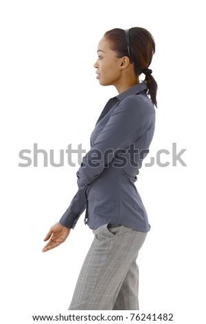 Smart woman posing in studio in profile.? - stock photo