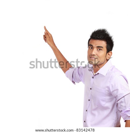 Smart young male business entrepreneur pointing at copyspace over white background