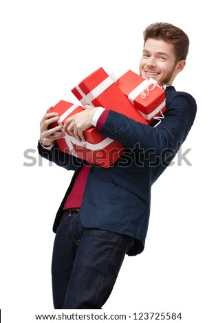 Smart young man carries a lot of heavy presents, isolated on white