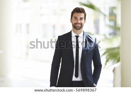 Smartly dressed businessman, smiling