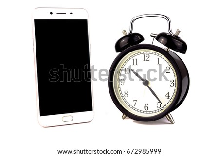 Smartphone and alarm clock on white background.Time management concept. Smartphone overuse or addiction is a dependence syndrome. Spend less time on smartphone for better productivity and creativity.  #672985999
