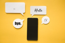 Smartphone and Message bubbles chat papper on yellow background