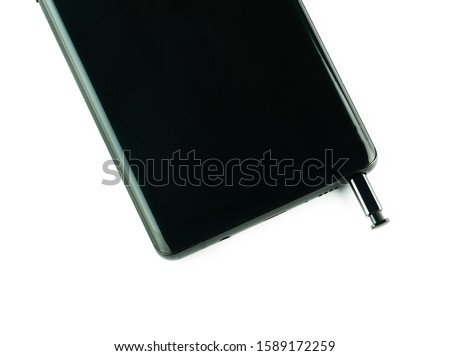 Photo of  Smartphone and stylus on a white background