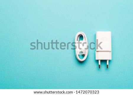 Smartphone charger on colorful background with copy space. Modern and minimal style. Minimal concept.