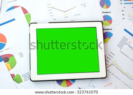 smartphone display green sceen ,business finance, tax, accounting, statistics and analytic research concept