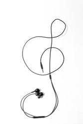 Smartphone earphone in the shape of a violin clef, vertical black and white image.