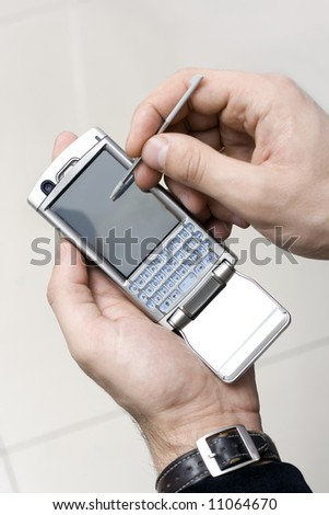 smartphone in a hand on the lght background