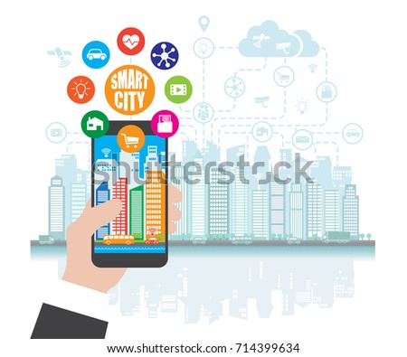 Smartphone in hand helps to focus in a smart city with advanced smart services, and augmented reality, social networking
