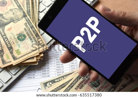 Smartphone in hand with message P2P. Peer to peer lending concept. #635517380