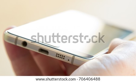 Smartphone in the hand, selective focus with shallow depth of field. #706406488