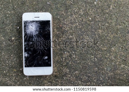 Smartphone mobile fall on the cement floor with touch screen broken. - Shutterstock ID 1150819598