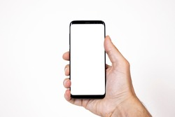 Smartphone mockup image of a man hand holding black mobile phone with blank screen on isolated background