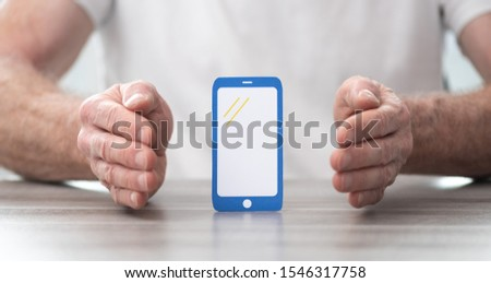 Smartphone protected by hands - Concept of mobile phone insurance