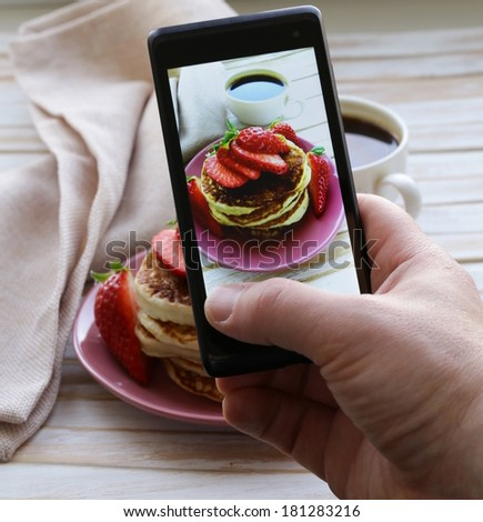 smartphone shot food photo pancakes for breakfast with fresh strawberries