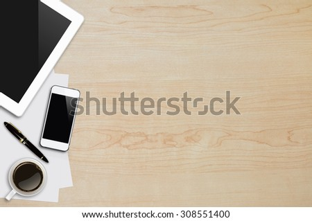 Smartphone, tablet, coffee cup, pen and page on wood background with copy space and text space