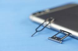 smartphone with a SIM card key, SIM card, SIM card space is open