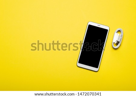 Smartphone with blank screen on colorful background with copy space. Modern and minimal style. Minimal concept.