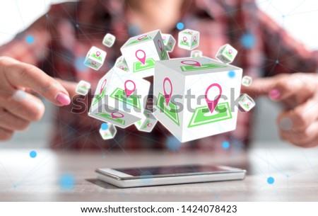 Smartphone with gps concept between hands of a woman in background #1424078423