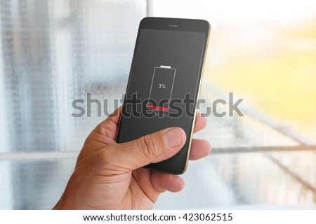 Smartphone with low battery on screen #423062515