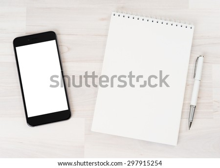 Smartphone with white screen isolated with a notebook on a light background
