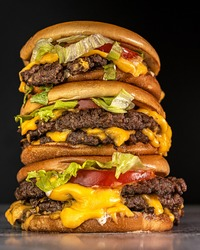 smash burger with american cheese, lettuce and tomato