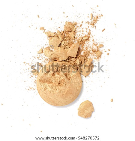 Smashed and cracked golden eye shadow isolated on a white background. #548270572