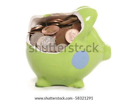 smashed piggy bank moneybox with British currency coins