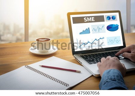 Shutterstock SME or Small and medium-sized enterprises Computing Computer  flare sun, Cropped image male freelancer sitting at the table