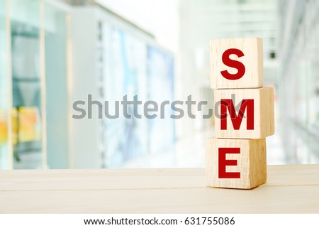 Shutterstock SME , Small and Medium Enterprise , business word on wooden cubes background, with copy space for text