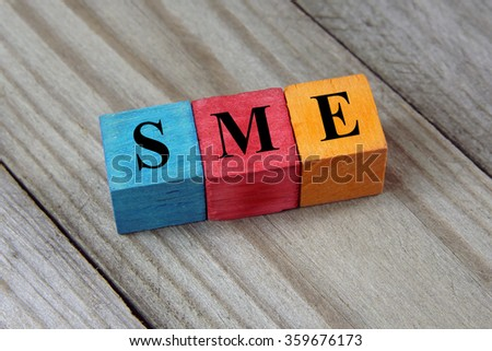 SME text (Small Medium Enterprises) on colorful wooden cubes