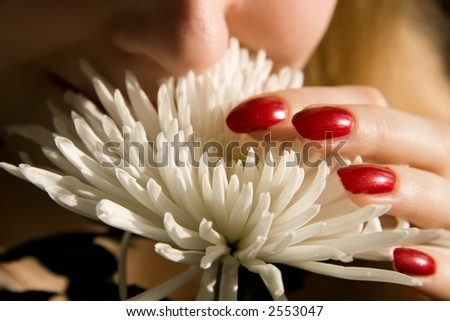 Smelling flower. Close view.
