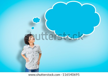 Smile asian boy with empty think bubble on blue background