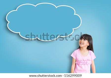 Smile asian little girl with empty think bubble on blue background