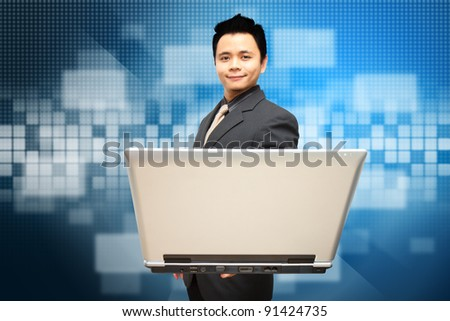 Smile Business man hold notebook computer with Digital windows