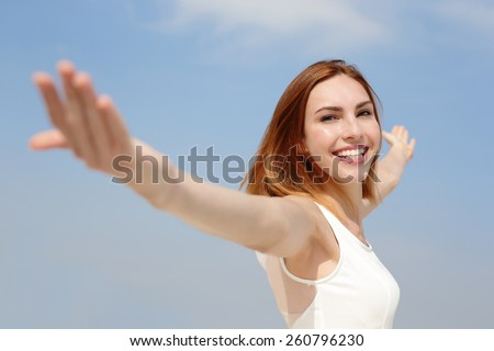 Smile Freedom and Carefree woman. She is enjoying nature during travel holidays vacation outdoors. caucasian beauty