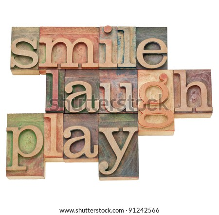 smile, laugh, play  - isolated word abstract in vintage wood letterpress printing blocks