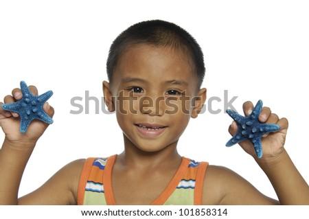 Smile little kids holding blue starfish