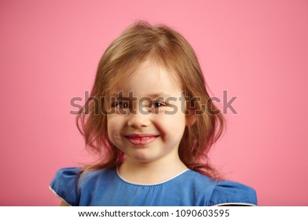 Smile of cheerful girl three years on pink background. #1090603595