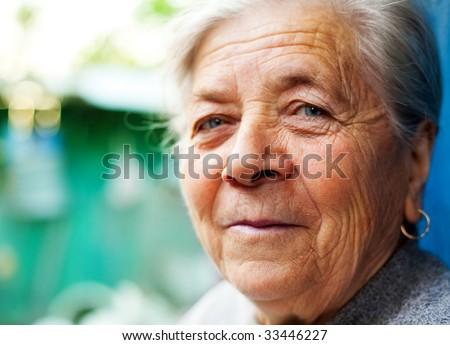 Smile of one content happy senior lady