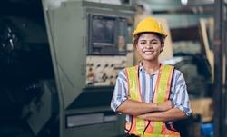 Smile technician engineer women  in factory