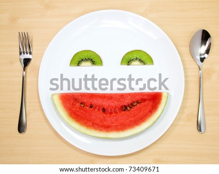 Smile watermelon and kiwi served on white plate