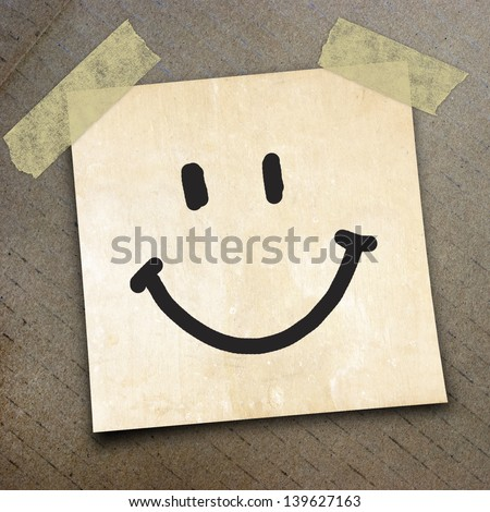 smile write on  paper on the packing paper box texture background