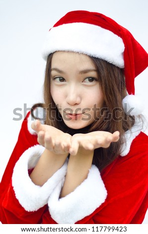 Smiley Asian santa woman. isolated on white background