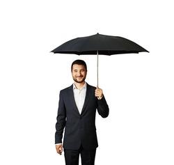 smiley businessman under umbrella. isolated on white background