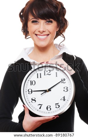 smiley businesswoman holding clock. isolated on white background
