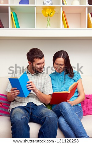 smiley couple looking at the book
